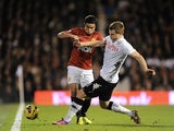 United right-back Rafael challenges John Arne Riise during the game with Fulham on February 2, 2013