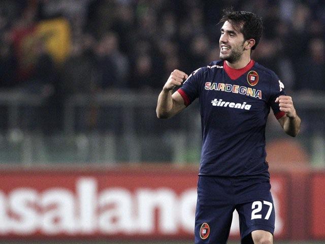 Cagliari forward Marco Sau celebrates scoring against Roma in their Serie A clash on February 1, 2013