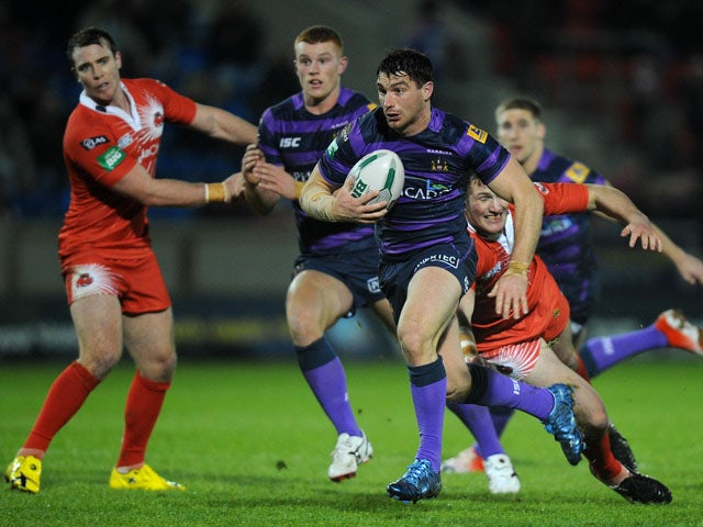 Wigan Warriors player Matty Smith skips away from a challenge in his team's match with Salford City Reds on February 1, 2013