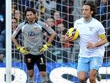 Lazio's Stefano Mauri with the ball celebrates scoring his team's second against Genoa on February 3, 2013
