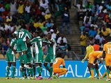 Sunday Mba is mobbed by his team mates after scoring the winner against Ivory Coast on February 3, 2013