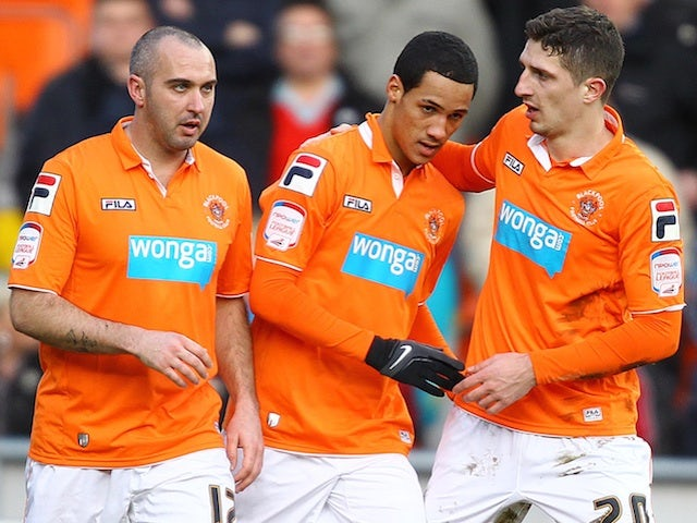 Blackpool players congratulate Tom Ince following his goal against Barnsley on February 2, 2013