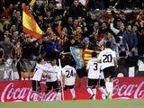 Valencia player Ever Banega celebrates with teammates after scoring against Barcelona on February 3, 2013