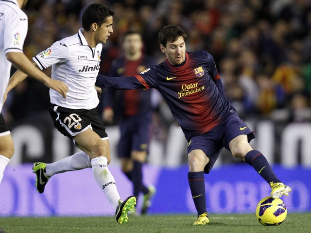 Barcelona's Lionel Messi on the ball during his side's match with Valencia on February 3, 2013