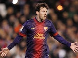 Barcelona's Lionel Messi celebrates after scoring in his side's match with Valencia on February 3, 2013