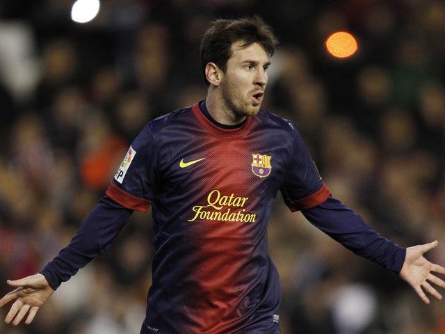 Messi hugs pitch invader