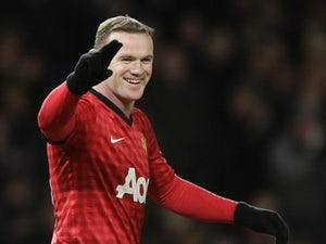 Rooney cools title talk