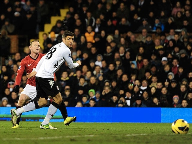 United forward Wayne Rooney opens the scoring at Fulham on February 2, 2013