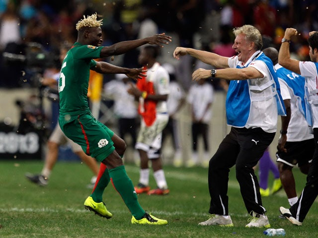 Burkina Faso player Aristide Bance celebrates with his head coach Paul Put after his side defeated Ghana in the African Cup of Nations on February 6, 2013