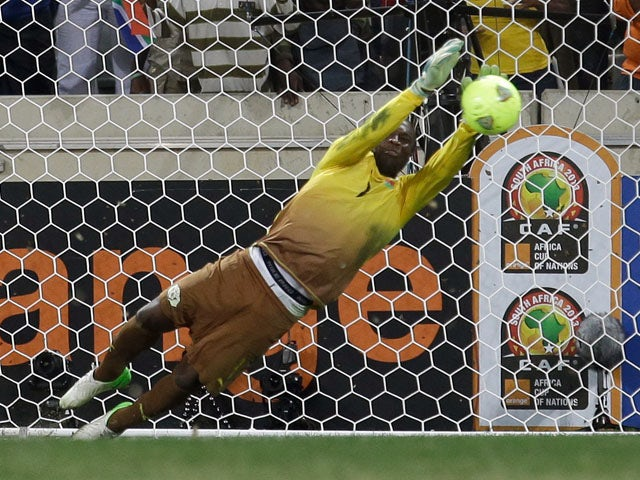Burkina Faso goalkeeper Daouda Diakite saves a penalty kick to win the match for his team during their penalty shoot out victory over Ghana on February 6, 2013