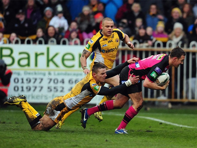 Leeds Rhinos' Danny McGuire scores a try against Castleford Tigers on February 10, 2013