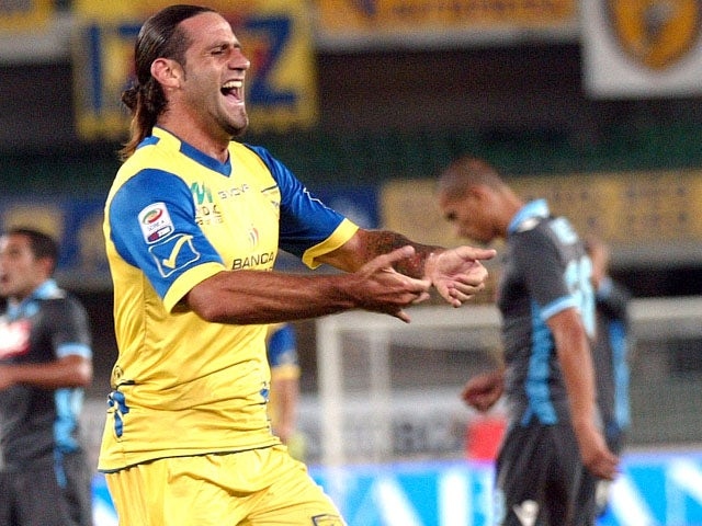 Chievo's Davide Moscardelli celebrates after scoring in his side's match on September 21, 2011