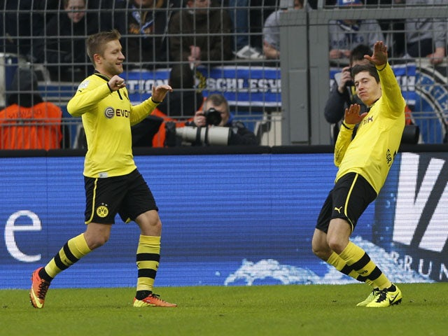 Dortmund's Robert Lewandowski celebrates opening the scoring in his team's match against Hamburg on February 9, 2013