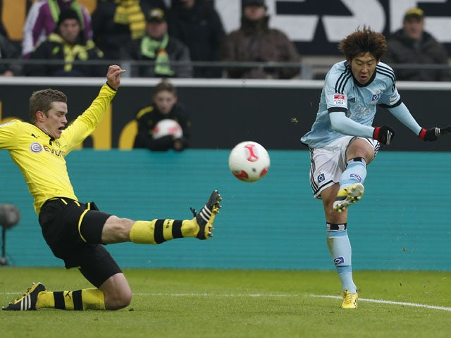Hamburg's Son Heung-min scores in his side's match against Dortmund on February 9, 2013