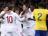 England players celebrate with Frank Lampard after he scored his side's second goal against Brazil on February 6, 2013