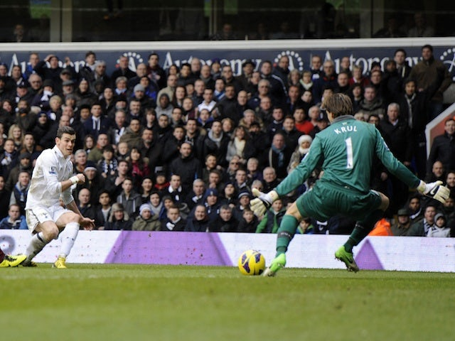 Spurs' Gareth Bale slots the ball past Tim Krul of Newcastle on February 9, 2013