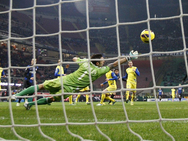 Inter Milan forward Diego Milito scores for his side against Chievo on February 10, 2013