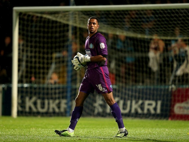Wycombe keeper attacked by fan