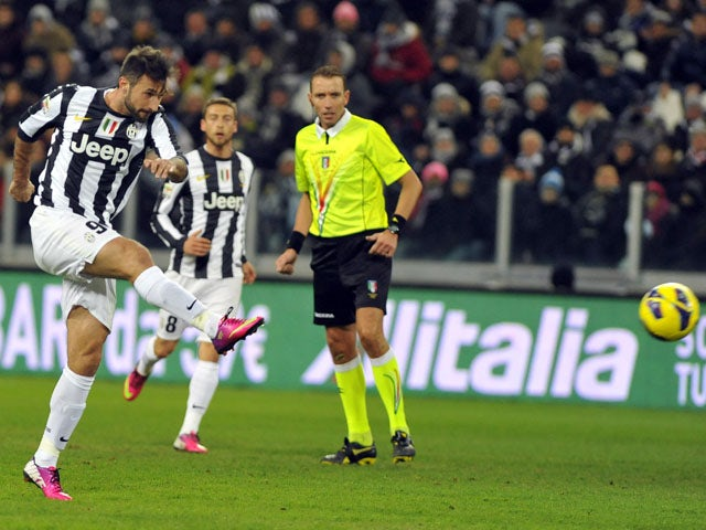 Mirko Vucinic scores for Juventus during their match with Fiorentina on February 9, 2013