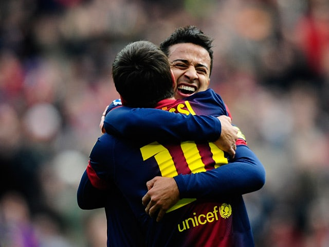 Barcelona's Lionel Messi is congratulated by team mate Thiago after scoring against Getafe on February 10, 2013
