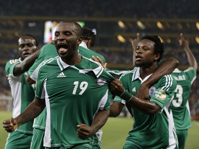 Nigeria's Sunday Mba celebrates alongside teammates after scoring against Burkina Faso in the African Cup of Nations final on February 10, 2013