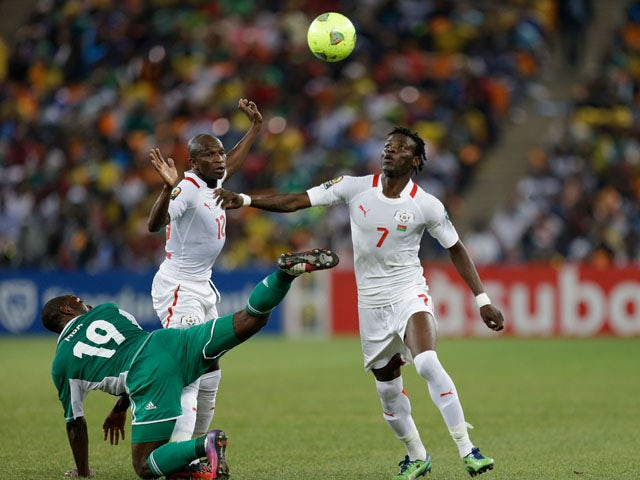 Burkina Faso player Florent Rouamba challenges for the ball during the final of the African Cup of Nations on February 10, 2013