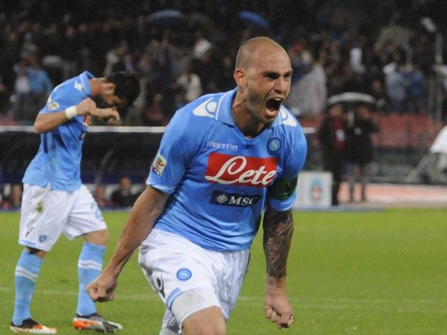 Napoli's Paolo Cannavaro celebrates after scoring against Novara on April 21, 2012