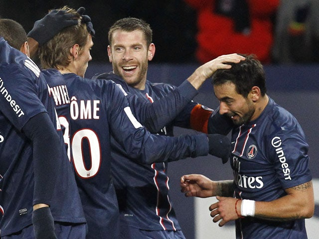 Paris Saint Germain's forward Ezequiel Lavezzi is congratulated by teammates after scoring in his side's match with Bastia on February 8, 2013