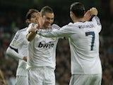 Real Madrid goalscorer Karim Benzema celebrates with teammates on February 9, 2013