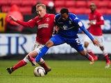 Birmingham's Rob Hall battles with Charlton's Chris Solly on February 9, 2013