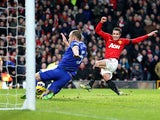 Robin Van Persie scores his team's second during the match against Everton on February 10, 2013