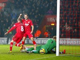 Southampton player Steven Davis celebrates scoring his team's second goal against Manchester City on February 9, 2013