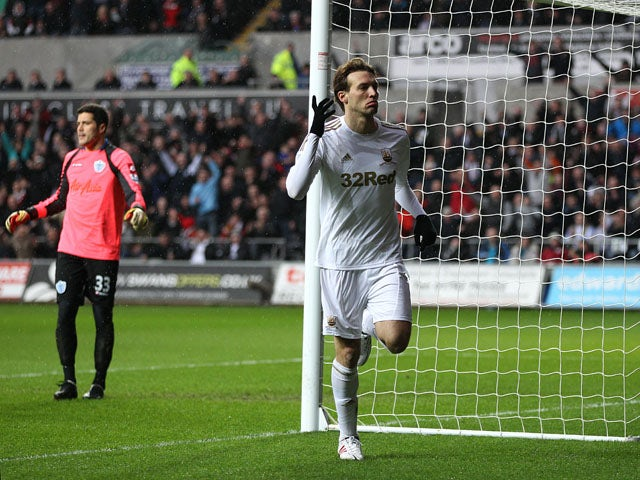 Swansea City forward Michu celebrates after scoring his side's first goal against QPR on February 9, 2013