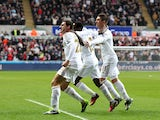 Swansea City's Angel Rangel celebrates alongside teammates after he scored against QPR on February 9, 2013