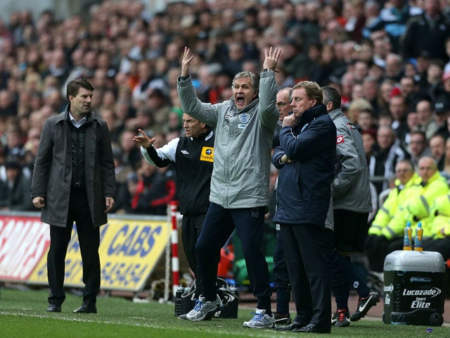 QPR manager Harry Redknapp watches on during his side's match against Swansea on February 9, 2013