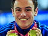 Tom Daley with his two gold medals on day three of the 2013 British Gas Diving Championships on February 10, 2013