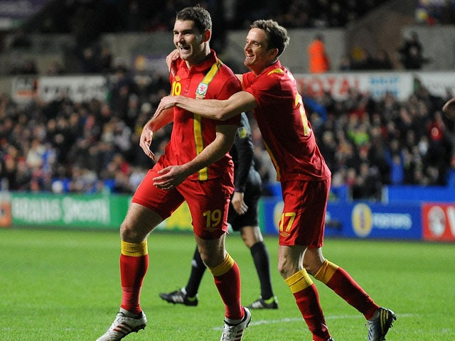 Wales player Samuel Vokes celebrates after scoring his side's second goal against Austria on February 6, 2013