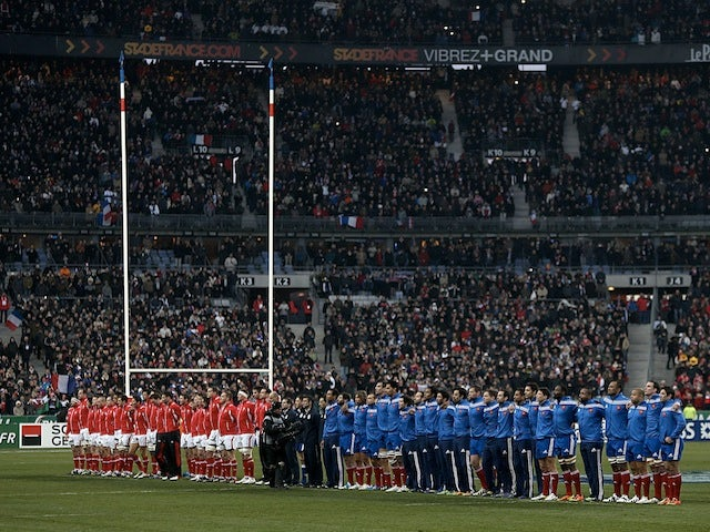 Welsh and French players line-up for the national anthems before the Six Nations match on February 9, 2013