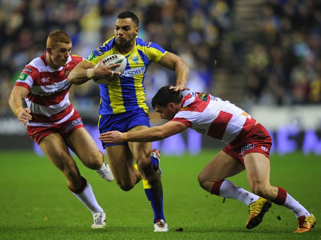 Warrington Wolves player Ryan Atkins is tackled by Wigan Warriors player Matty Smith on February 8, 2013