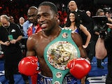 Adrien Broner celebrates after knocking off Gavin Rees in the 5th round of their WBC lightweight title match on February 17, 2013