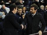 Tottenham Hotspur boss Andre Villas-Boas shakes hands with Lyon boss Remi Garde before kick-off on February 14, 2013