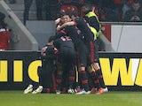 Benfica players celebrate a goal by Oscar Cardozo on February 14, 2013