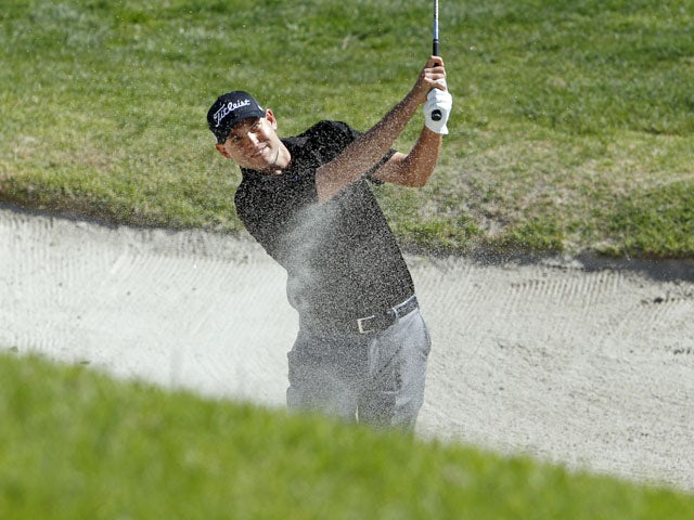 Bill Haas hits from the bunker during the final round of the Northern Trust Open golf tournament on February 17, 2013