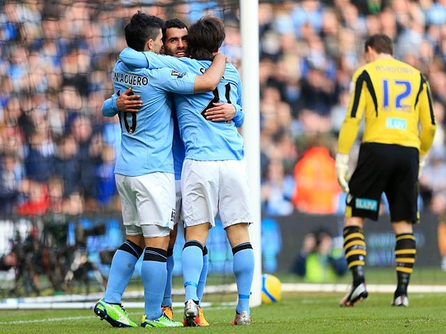 Manchester City's Carlos Tevez is congratulated by David Silva and Sergio Aguero after scoring his team's third against Leeds in the FA Cup 5th round on February 17, 2013