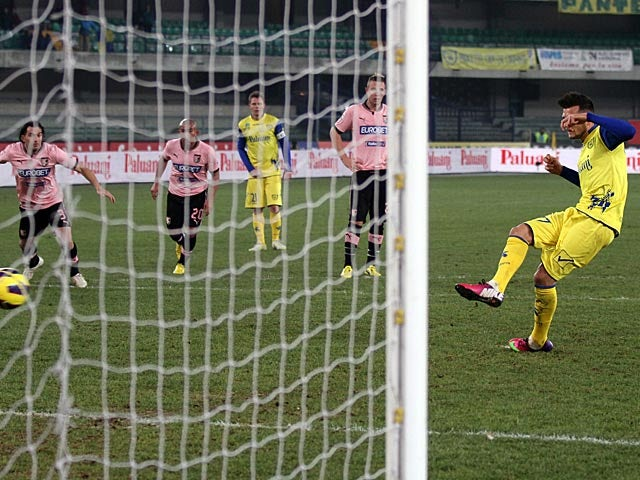 Chievo Verona's Cyril Thereau slots home a penalty to equalise against Palermo on February 16, 2013
