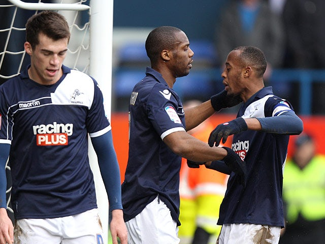 Millwall's Dany N'Guessan is congratulated by team mates after scoring his team's third in the FA Cup 5th round tie against Luton on February 16, 2013