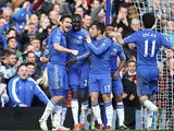 Chelsea's Frank Lampard is congratulated by team mates after scoring his team's third in the FA Cup 4th round replay against Brentford on February 17, 2013