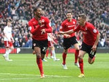 Cardiff's Frazier Campbell celebrates with team mates after scoring his second against Bristol City on February 16, 2013