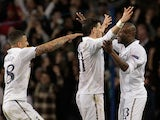 Gareth Bale is congratulated by team mates Kyle Walker and William Gallas after scoring the opener in the Europa League match against Lyon on February 14, 2013