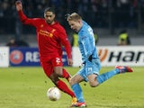 Liverpool's Glen Johnson fights for the ball with Zenit's Tomas Hubochan on February 14, 2013